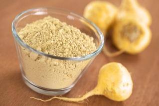 maca-powder-flour-in-glass-bowl-with-maca-roots-or-peruvian-ginseng-lat-lepidium-meyenii