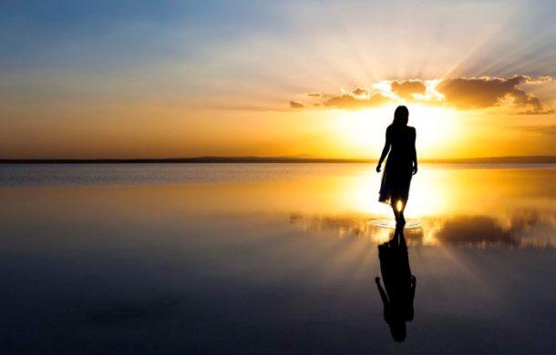 Walking on water at sunset